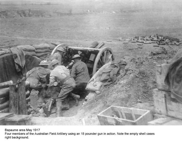 Photo of the Australian Field Artillery using an 18 pounder gun in the Bapaume area, May 1917